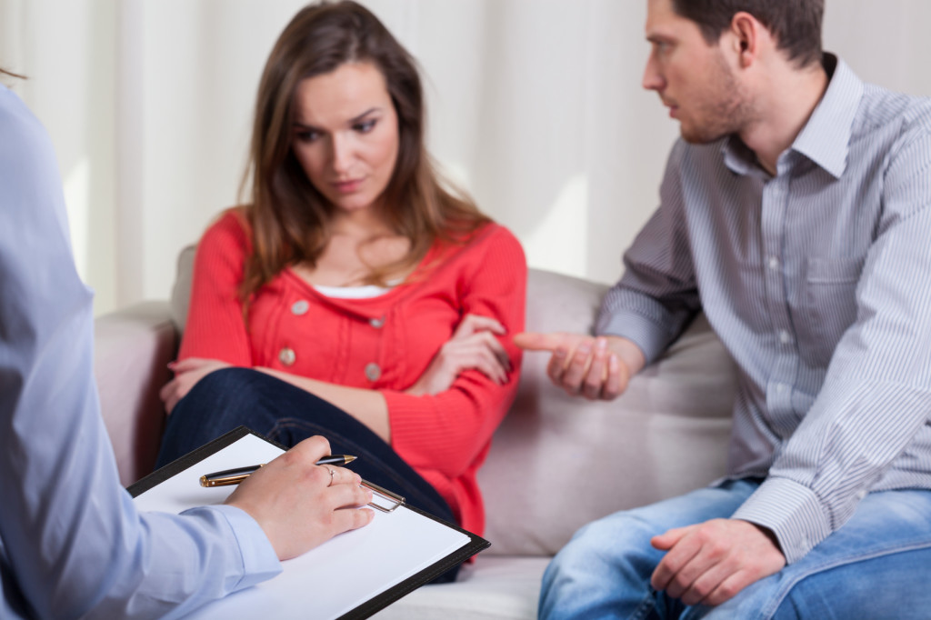 Man trying to talk with his wife on therapy